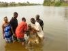 Baptizing in Guinea