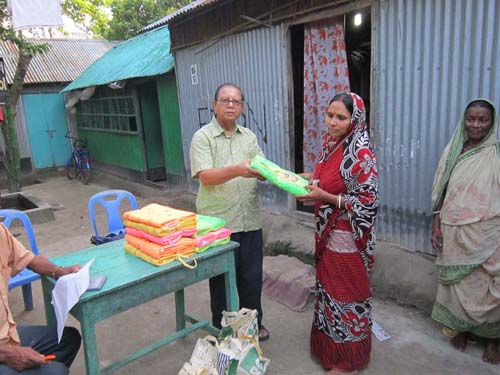 Distributing rice and mosquito nets